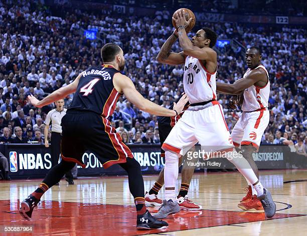 DeMar DeRozan of the Toronto Raptors shoots the ball as Josh McRoberts of the Miami Heat defends in the first half of Game Five of the Eastern...