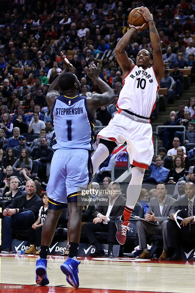 DeMar DeRozan #10 of the Toronto Raptors shoots the ball as Lance Stephenson #1 of the Memphis Grizzlies defends during the second half of an NBA game at the Air Canada Centre on February 21, 2016 in Toronto, Ontario, Canada.