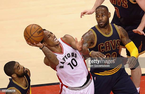 DeMar DeRozan of the Toronto Raptors shoots the ball as LeBron James of the Cleveland Cavaliers reacts during the second half in game three of the...