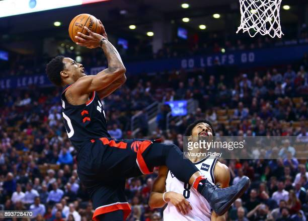 DeMar DeRozan of the Toronto Raptors shoots the ball as Spencer Dinwiddie of the Brooklyn Nets defend during the first half of an NBA game at Air...
