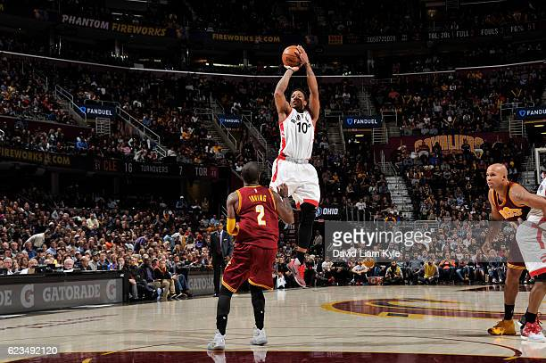 DeMar DeRozan of the Toronto Raptors shoots the ball over Kyrie Irving of the Cleveland Cavaliers during a game on November 15 2016 at Quicken Loans...