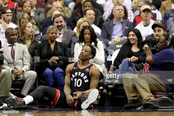 DeMar DeRozan of the Toronto Raptors sits on the floor after getting called for a foul in the second half against the Washington Wizards during Game...