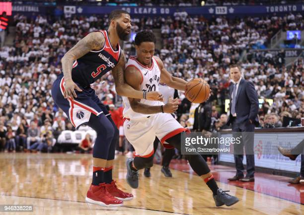 DeMar DeRozan of the Toronto Raptors tries to get past Markieff Morris of the Washington Wizards in the third quarter during Game One of the first...