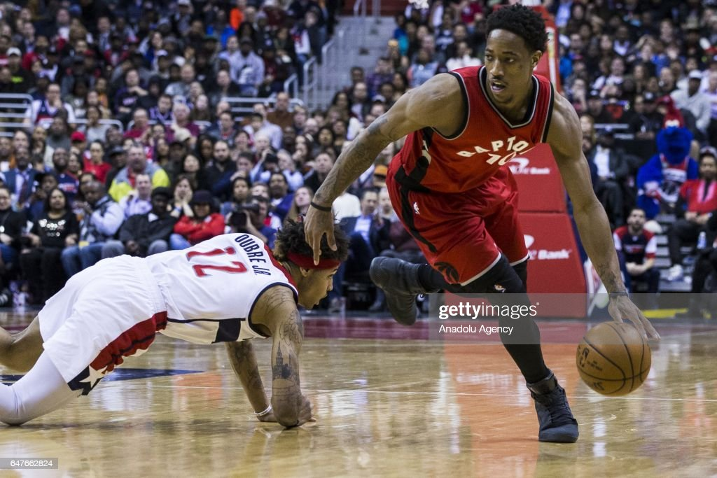 DeMar DeRozan (10) of Toronto Raptors in action against Kelly Oubre (12) of Washington Wizards during the NBA match between Washington Wizards and Toronto Raptors at the Verizon Center in Washington, United States on March 3, 2017.