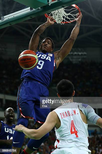 Demar DeRozan of United States dunks the ball over Jiwei Zhao of China in the Men's Preliminary Round Group A match on Day 1 of the Rio 2016 Olympic...
