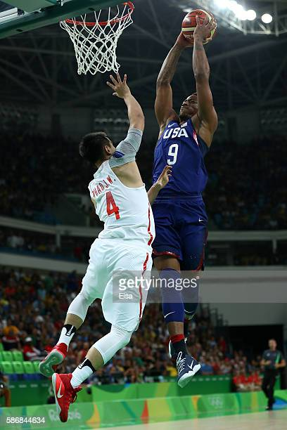 Demar DeRozan of United States goes the basket against Jiwei Zhao of China in the Men's Preliminary Round Group A match on Day 1 of the Rio 2016...