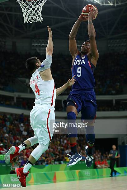 Demar DeRozan of United States goes to the basket against Jiwei Zhao of China in the Men's Preliminary Round Group A match on Day 1 of the Rio 2016...