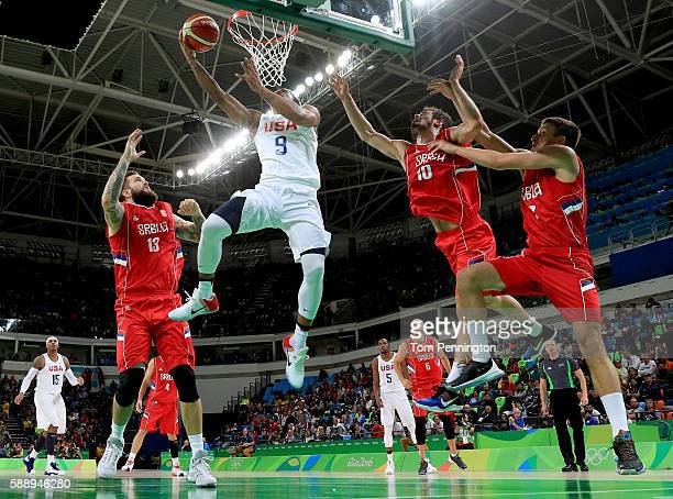 Demar DeRozan of United States goes up for a shot against Nikola Kalinic of Serbia in the Men's Preliminary Round Group A match on Day 7 of the Rio...
