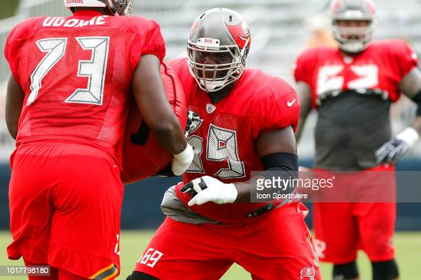 Demar Dotson of the Bucs goes thru a blocking drill during the joint training camp work out between the Tampa Bay Buccaneers and the Tennessee Titans...