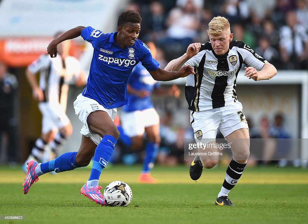 Demarai Gray of Birmingham City battles with Elliott Whitehouse of Notts County during the Pre Season Friendly match between Notts County and Birmingham City at Meadow Lane on July 29, 2014 in Nottingham, England.
