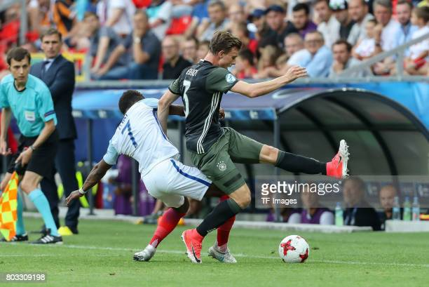 Demarai Gray of England and Yannick Gerhardt of Germany battle for the ball during the UEFA European Under21 Championship Semi Final match between...