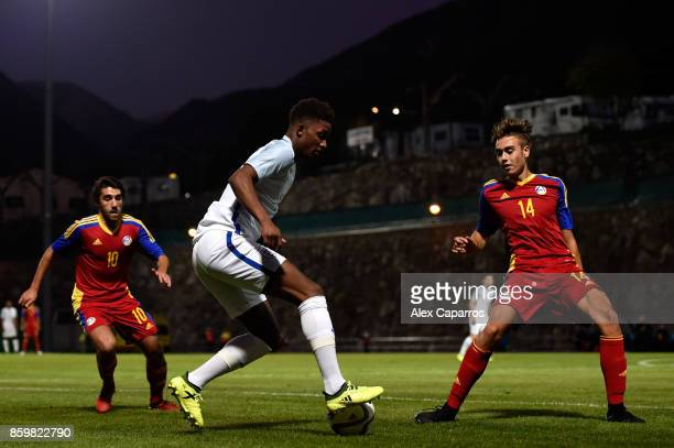 Demarai Gray of England is challenged by Albert Grau Samper of Andorra during the UEFA European Under 21 Championship Qualifier between Andorra U21...