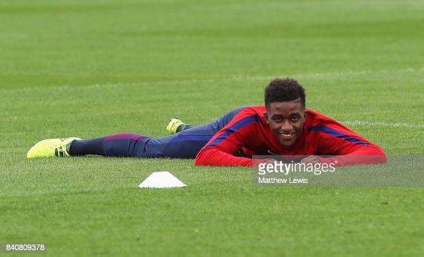Demarai Gray of England looks on as he lies on the ground during an England Under 21 training session at St George's Park on August 30 2017 in...