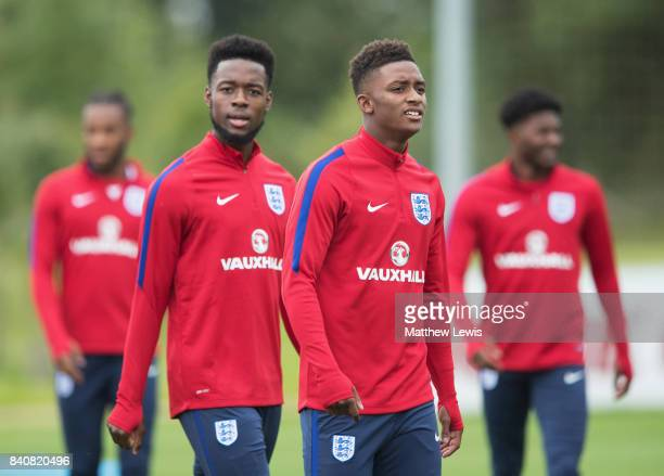 Demarai Gray of England looks on with Josh Onomah during an England Under 21 training session at St George's Park on August 30 2017 in...