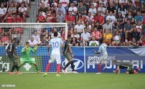 Demarai Gray of England scores his sides first goal past Jannik Pollersbeck of Germany during the UEFA European Under21 Championship Semi Final match...