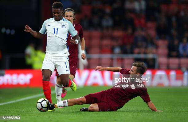 Demarai Gray of England U21 is tackled by Kriss Karklins of Latvia U21 during the UEFA Under 21 Championship Qualifier match between England and...