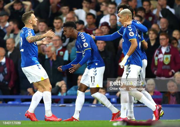 Demarai Gray of Everton celebrates scoring his teams third goal during the Premier League match between Everton and Burnley at Goodison Park on...