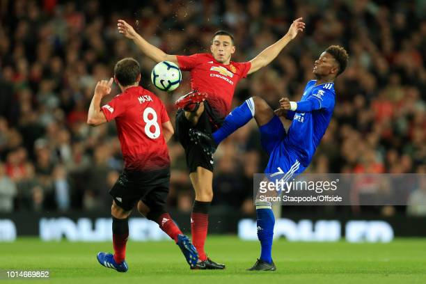Demarai Gray of Leicester battles with Juan Mata of Man Utd and Matteo Darmian of Man Utd during the Premier League match between Manchester United...