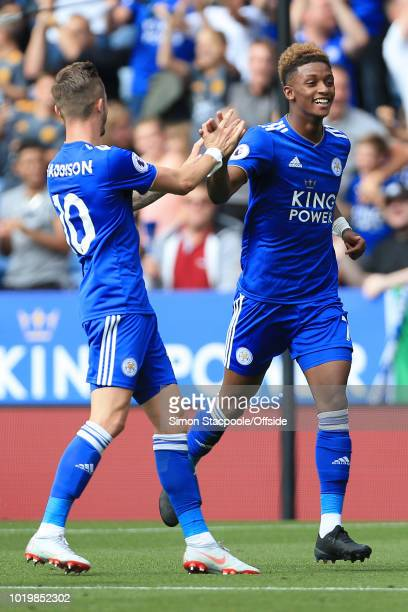 Demarai Gray of Leicester celebrates with teammate James Maddison of Leicester following their 1st goal during the Premier League match between...