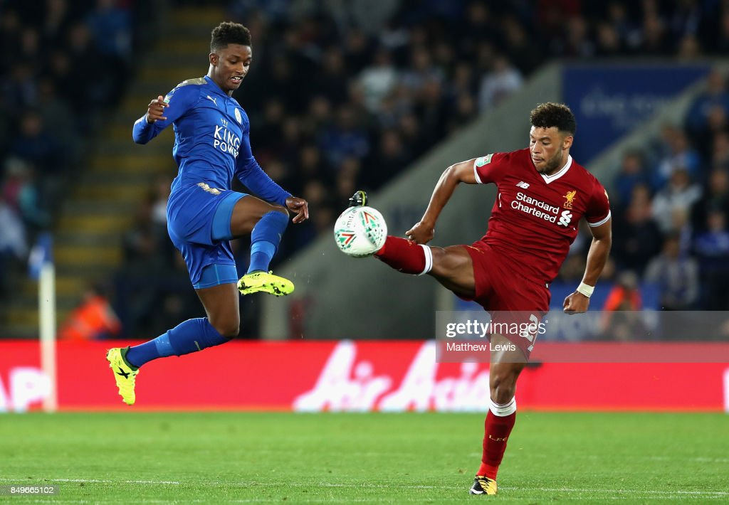 Demarai Gray of Leicester City and Alex Oxlade-Chamberlain of Liverpool battle for possession during the Carabao Cup Third Round match between Leicester City and Liverpool at The King Power Stadium on September 19, 2017 in Leicester, England.