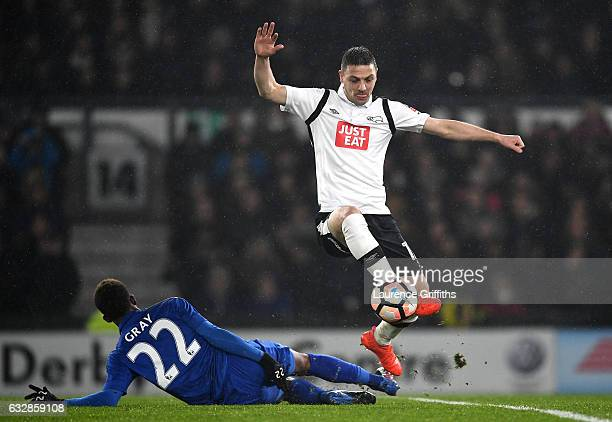 Demarai Gray of Leicester City and Chris Baird of Derby County in action during The Emirates FA Cup Fourth Round match between Derby County and...