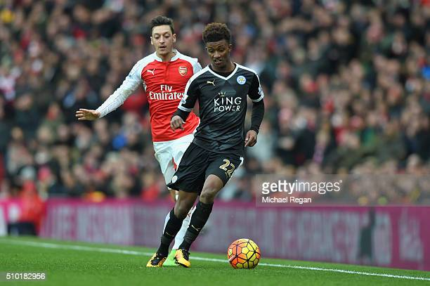 Demarai Gray of Leicester City and Mesut Ozil of Arsenal in action during the Barclays Premier League match between Arsenal and Leicester City at the...