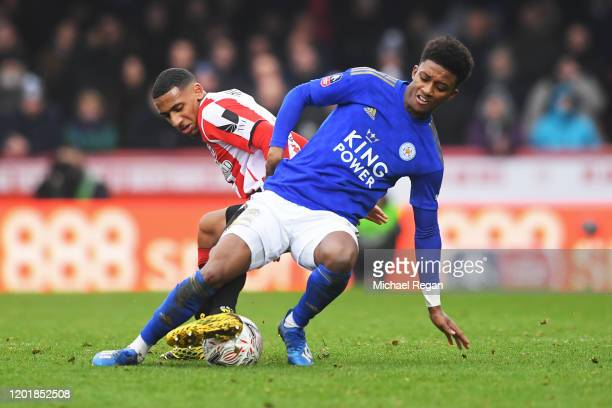 Demarai Gray of Leicester City battles for possession with Dominic Thompson of Brentford during the FA Cup Fourth Round match between Brentford FC...