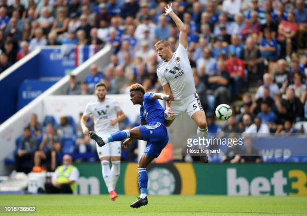 Demarai Gray of Leicester City battles for possession with Ryan Bennett of Wolverhampton during the Premier League match between Leicester City and...