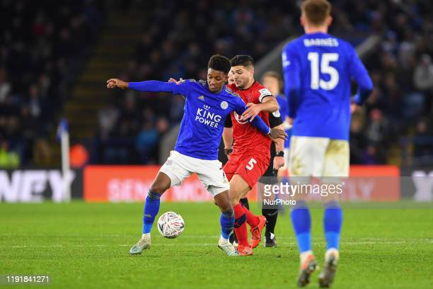 Demarai Gray of Leicester City battles with Sam Morsy of Wigan Athletic during the FA Cup Third Round match between Leicester City and Wigan Athletic...