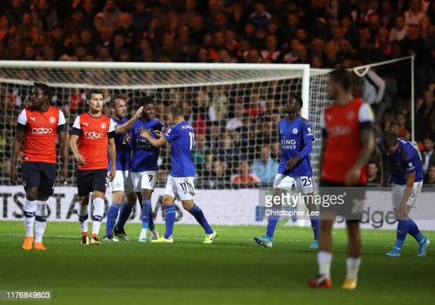 Demarai Gray of Leicester City celebrates after scoring his sides first goal during the Carabao Cup Third Round match between Luton Town and...