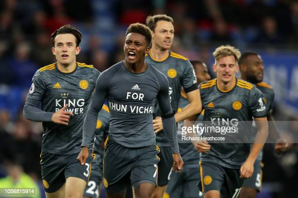 Demarai Gray of Leicester City celebrates after scoring his team's first goal by revealing a commemorative for Vichai Srivaddhanaprabha during the...