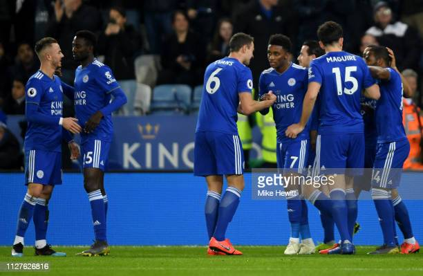 Demarai Gray of Leicester City celebrates as he scores his team's first goal with team mates during the Premier League match between Leicester City...