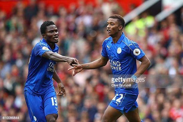 Demarai Gray of Leicester City celebrates scoring his sides first goal with Daniel Amartey of Leicester City during the Premier League match between...