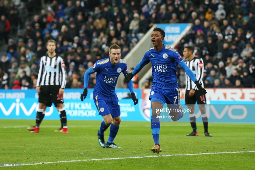 Demarai Gray of Leicester City celebrates scoring the 2nd Leicester goal with Jamie Vardy during the Premier League match between Newcastle United and Leicester City at St. James Park on December 9, 2017 in Newcastle upon Tyne, England.