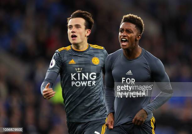 Demarai Gray of Leicester City celebrates with Ben Chilwell of Leicester City after scoring his team's first goal by revealing a commemorative for...