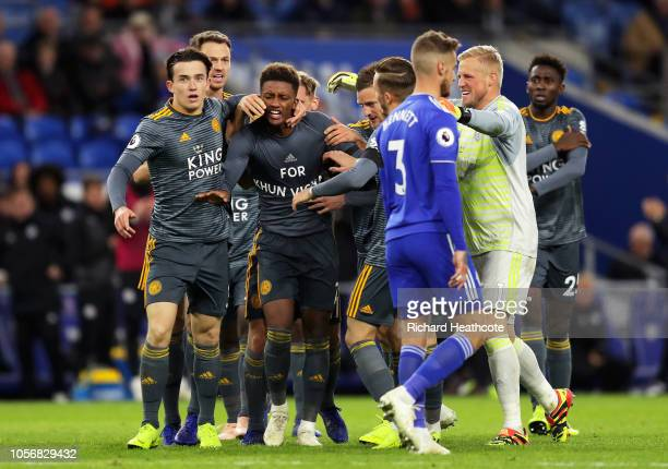 Demarai Gray of Leicester City celebrates with his team mates after scoring his team's first goal by revealing a commemorative for Vichai...