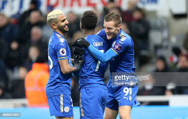 Demarai Gray of Leicester City celebrates with Riyad Mahrez and Jamie Vardy of Leicester City after scoring to make it 12 during the Premier League...