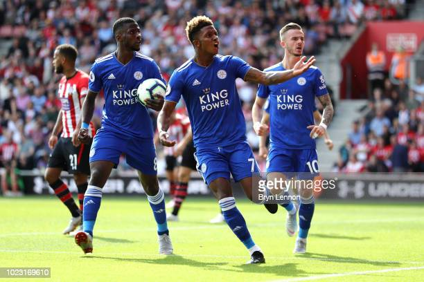 Demarai Gray of Leicester City celebrates with team mates after scoring his sides first goal during the Premier League match between Southampton FC...