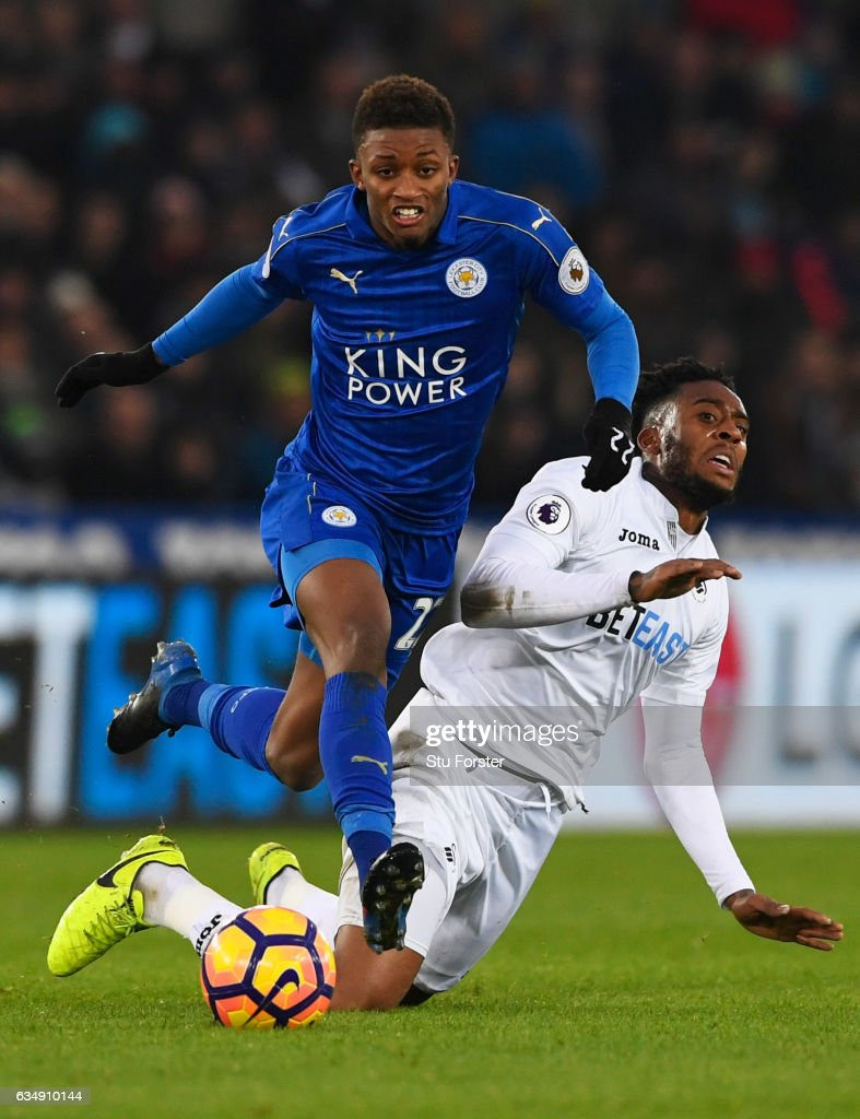 Demarai Gray of Leicester City evades Leroy Fer of Swansea City during the Premier League match between Swansea City and Leicester City at Liberty Stadium on February 12, 2017 in Swansea, Wales.