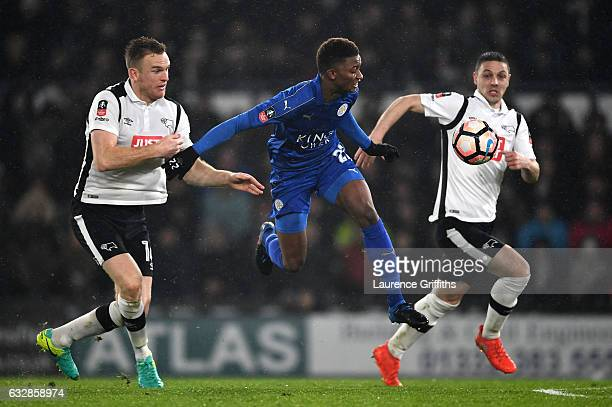 Demarai Gray of Leicester City holds of Alex Pearce of Derby County during The Emirates FA Cup Fourth Round match between Derby County and Leicester...