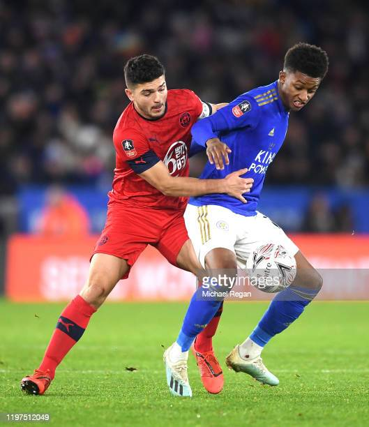 Demarai Gray of Leicester City holds of Sam Sayed Morsy of Wigan Athletic during the FA Cup Third Round match between Leicester City and Wigan...