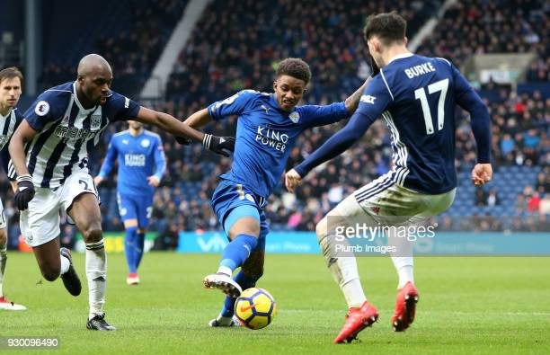 Demarai Gray of Leicester City in action with Allan Nyom and Oliver Burke of West Bromwich Albion during the Premier League match between West...