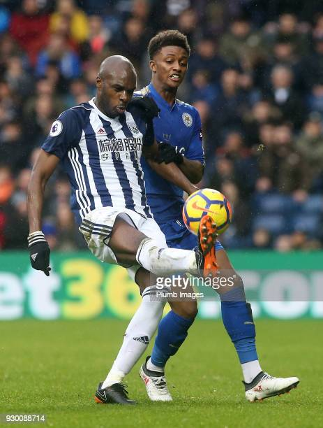 Demarai Gray of Leicester City in action with Allan Nyom of West Bromwich Albion during the Premier League match between West Bromwich Albion and...