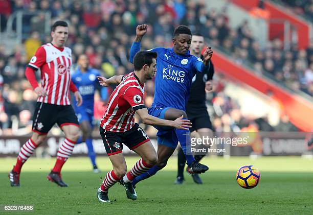 Demarai Gray of Leicester City in action with Cedric of Southampton during the Premier League match between Southampton and Leicester City at St...