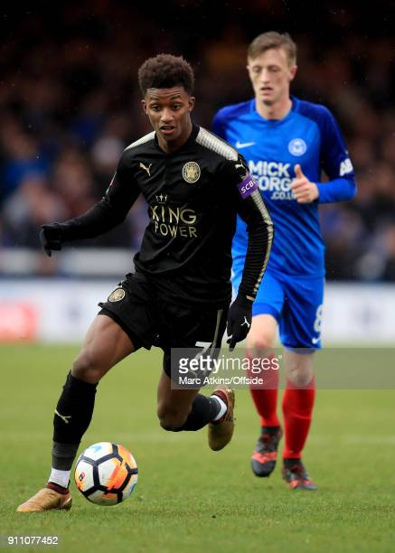 Demarai Gray of Leicester City in action with Chris Forrester of Peterborough United during the FA Cup 4th Round match between Peterborough United...