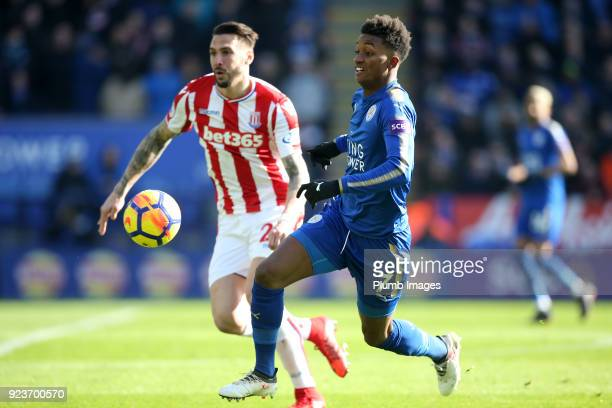Demarai Gray of Leicester City in action with Geoff Cameron of Stoke City during the Premier League match between Leicester City and Stoke City at...