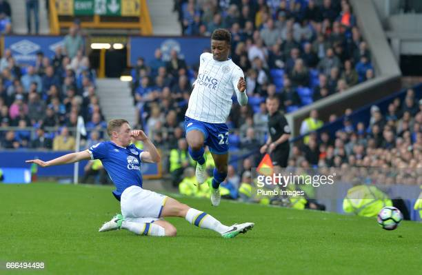 Demarai Gray of Leicester City in action with Matthew Pennington of Everton during the Premier League match between Everton and Leicester City at...