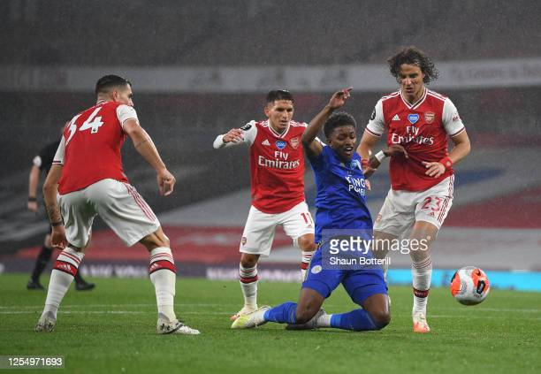 Demarai Gray of Leicester City is challenged by David Luiz of Arsenal as Lucas Torreira and Sead Kolasinac look on during the Premier League match...