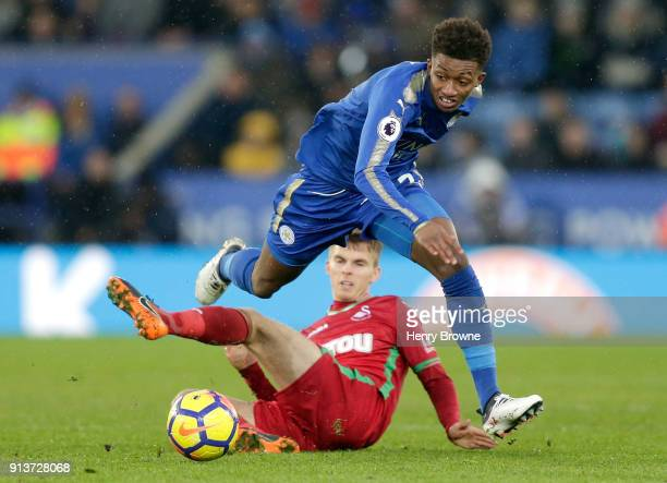 Demarai Gray of Leicester City is tackled by Tom Carroll of Swansea City during the Premier League match between Leicester City and Swansea City at...