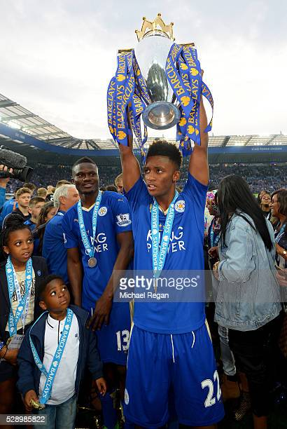 Demarai Gray of Leicester City lifts the Premier League Trophy as players celebrate the season champions after the Barclays Premier League match...
